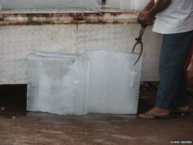 Two large blocks of ice next to a chest