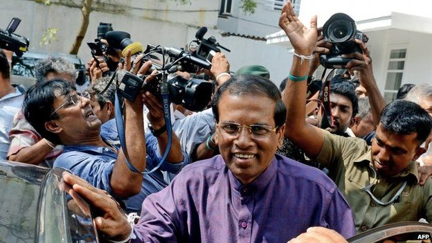Sri Lanka's newly elected president Maithripala Sirisena leaves the opposition leader's office after meeting with political leaders who supported him, in the capital Colombo on January 9,