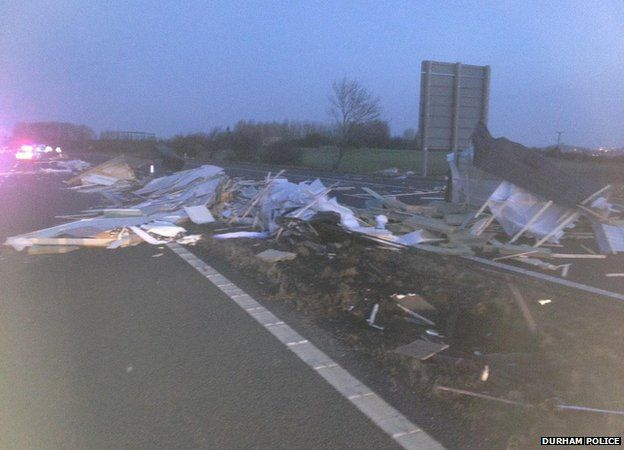 Shed blown onto A1