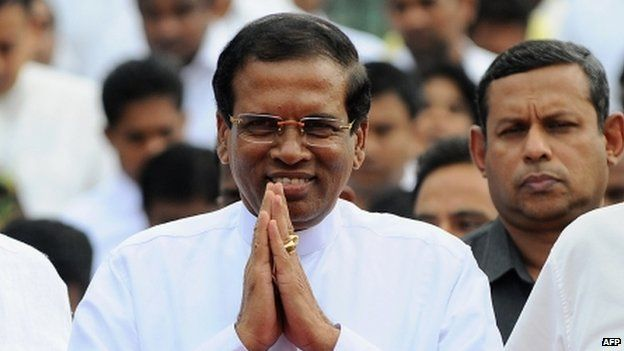 Sri Lankan President Maithripala Sirisena arrives to address the nation from outside the Buddhist Temple of Tooth in the central town of Kandy (11 January 2015)