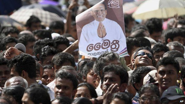 Supporters of President Maithripala Sirisena listen as he addresses the nation outside the Temple of Tooth in Kandy (11 January 2015)