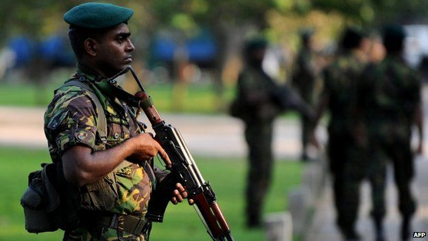 A Sri Lankan Special Task Force (STF) soldier stands guard as Sri Lanka's newly-elected president Maithripala Sirisena is sworn in at Independence Square in Colombo (09 January 2015)