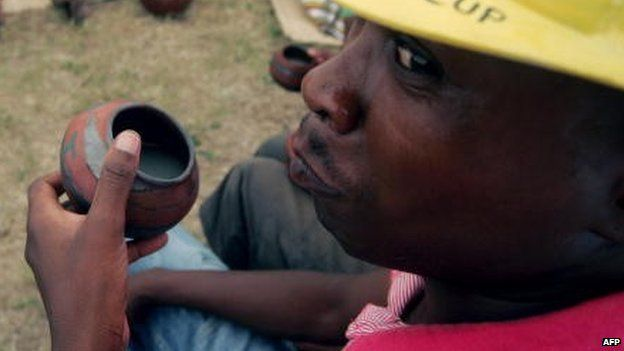 A man drinks traditional beer in Polokwane, South Africa, on 26 February 2010