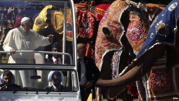 The Pope drives past ceremonial elephants in Sri Lanka