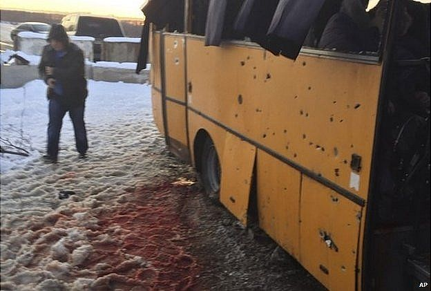 Snow covered with blood by a bus destroyed by a shell at the checkpoint near the town of Volnovakha. 13 Jan 2015