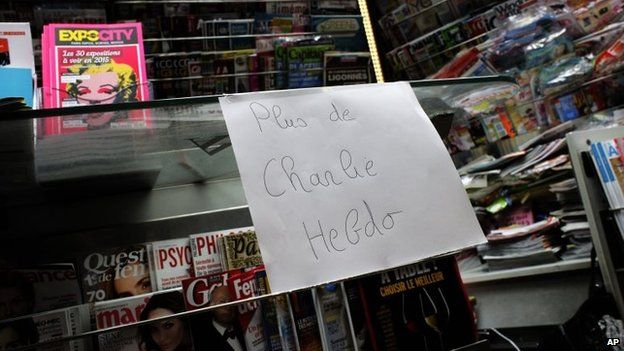 """A note that reads: """"No more Charlie Hebdo"""" is posted after all copies of the satirical newspaper were sold out at a newsstand in Paris, 14 January 2015"""