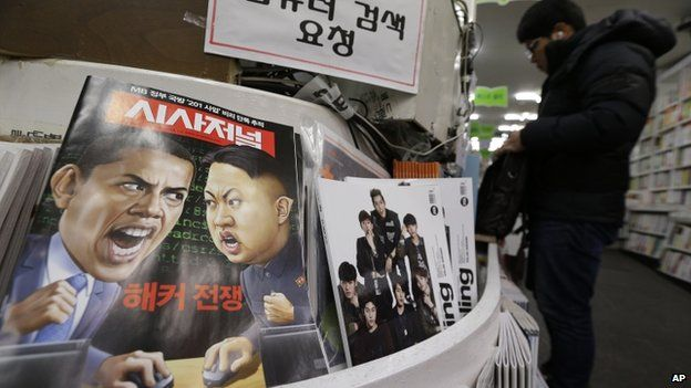 A magazine with caricatures of US President Barack Obama and North Korean leader Kim Jong-un is displayed at a book store in Seoul