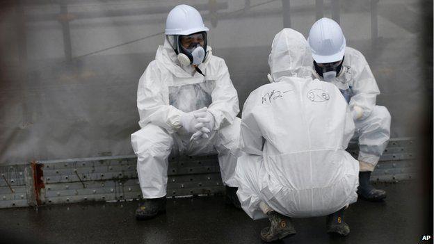 Workers at the Fukushima Daiichi nuclear power plant in November 2014