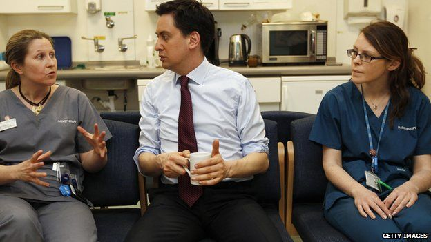 Ed Miliband chatting with radiotherapists at a London hospital