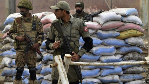 Pakistani troops keep watch near the Kot Lakhpat Jail on the outskirts of Lahore on 8 January 2015.