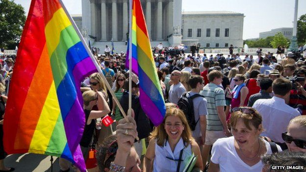 Gay rights activists gather outside the US Supreme Court building in Washington, DC 26 June 2013