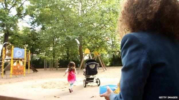 A woman watches her child in a German park