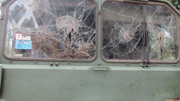 Bullet holes in a car windscreen in CAR