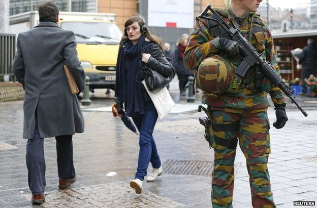 Belgian soldiers patrol outside the European Council headquarters in central Brussels, 19 Jan