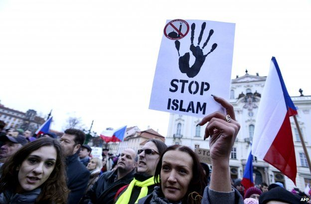 People attend an anti-Islam rally in Prague, 19 January