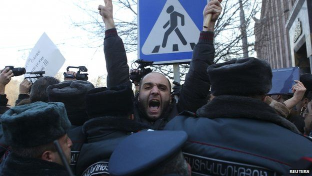 Protesters demanding the suspect behind a massacre of seven family members be handed to the Armenian authorities
