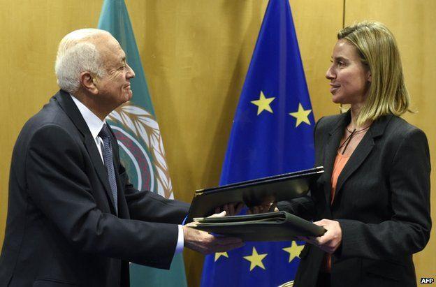 Arab League Secretary General Nabil al-Arabi (left) exchanges documents with the EU's Federica Mogherini in Brussels, 19 January