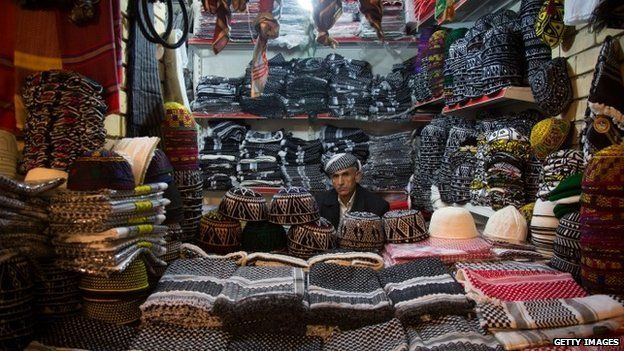 A trader inside the Qaysari Bazaar in Erbil
