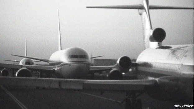 Passenger jets queuing on runway