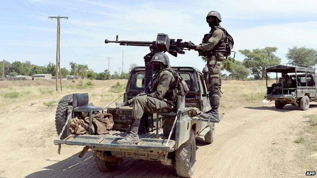 Cameroonian soldiers patrolling in Amchide, northern Cameroon, near Nigerian border. 12 Nov 2014