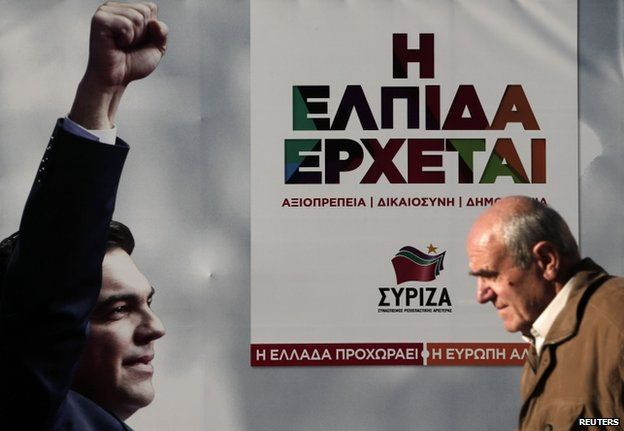 A man walks past a banner with an image of Syriza party leader Alexis Tsipras at the party's pre-election kiosk in Athens 15 January 2015