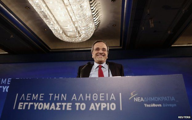 Greece's Prime Minister and leader of the ruling conservative New Democracy party Antonis Samaras smiles as he steps on the stage to deliver a pre-election speech outlining his policies in Athens 10 January 2015.