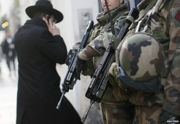 French soldiers patrol a Jewish neighbourhood in Paris, 20 January