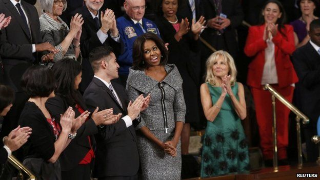 Michelle Obama reacts to the cheers of the audience as she attends US President Barack Obama's State of the Union address