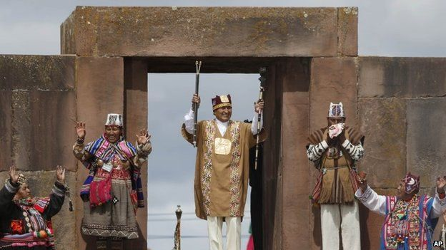 """Bolivia""""s president Evo Morales holds his sacred staffs of power during a blessing by Aymaran spiritual guides, in a traditional ceremony at the archaeological site Tiwanaku, Bolivia, Wednesday, Jan. 21, 2015"""