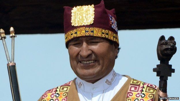 Handout picture released by the Bolivian presidency showing reelected Bolivian President Evo Morales showing ceremonial staffs after receiving them in a ritual ceremony at the Kalasasaya temple in the archaeological site of Tiwanaku, about 70 km from La Paz, ahead of his swearing-in for a third mandate, on January 21, 2015