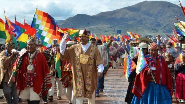 Bolivian President Evo Morales (C) participating in a ritual ceremony at the archaeological site of Tiwanaku, about 70 km from La Paz, ahead of his swearing-in for a third mandate, on January 21, 2015