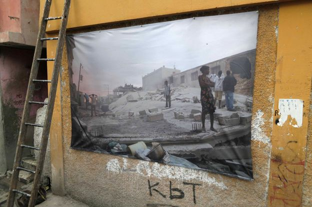 A large copy of one of Morel's photos on a wall