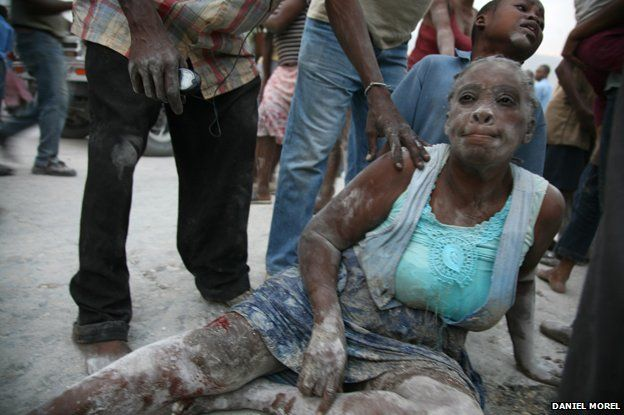A woman covered in dust after the earthquake