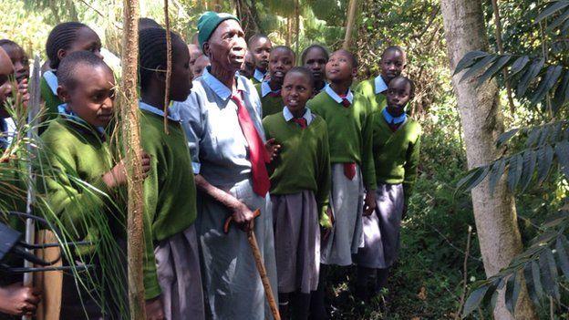 Priscilla Sitienei and classmates standing outside