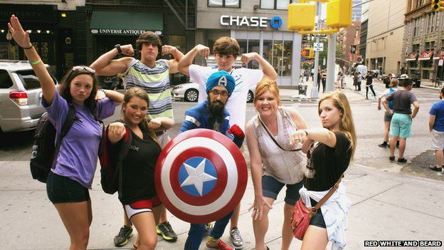 Singh takes a photo with a New York crowd
