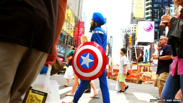 Singh crossing the street in Times Square