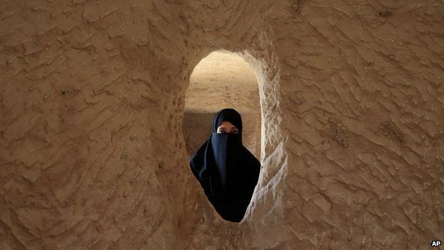 Saudi woman poses for photo inside the Qasr al-Bint tombs complex in the desert archaeological site of Madain Saleh, in Al Ula city, 10 May 2012