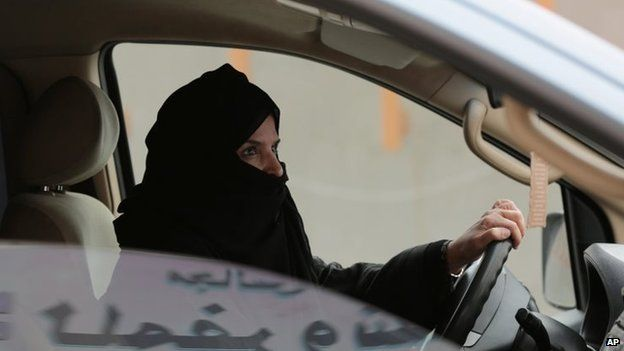 Aziza Yousef drives a car on a highway in Riyadh, Saudi Arabia, as part of a campaign to defy Saudi Arabia's ban on women driving on 29 March 2014