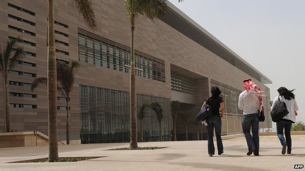 File photo: A man walks with two unveiled women at the campus of the King Abdullah University of Science and Technology (KAUST) in Thuwal, 80 kilometers north of Jeddah, 13 October 2009