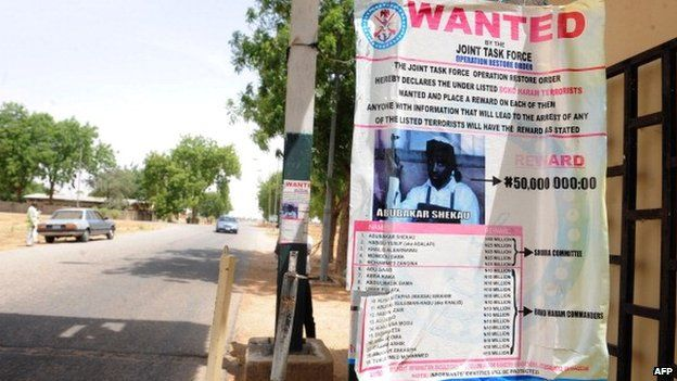 A poster displayed along the road shows photograph of Imam Abubakar Shekau, leader of the militant Islamist group Boko Haram, declared wanted by the Nigerian military - Maiduguri, Nigeria, 1 May 2013