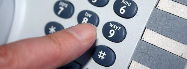 Generic pic of someone dialling a number