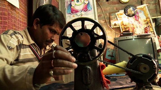 Santosh at his sewing machine