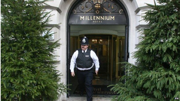 Police officer outside the Millennium Hotel