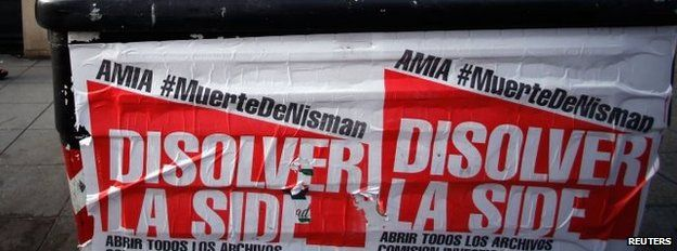 "Posters on a rubbish container read ""Dissolve the Side"""