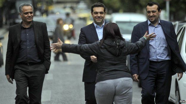 Alexis Tsipras is hugged by a supporter (26 Jan)