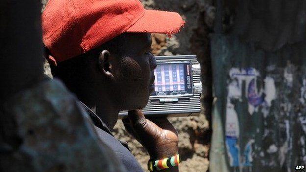 A Kenyan man listens to news on a radio on 5 March 2013 in Nairobi's sprawling Kibera slum