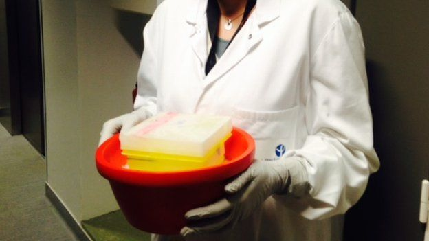 Ebola sample being carried