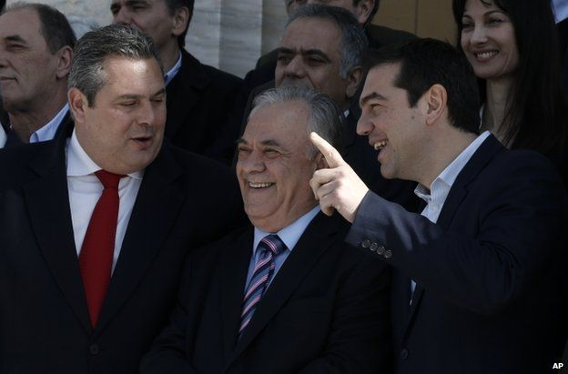 Prime Minister Alexis Tsipras, right, Deputy Prime Minister Giannis Dragasakis, centre, and Defence Minister Panos Kammenos in Athens, 28 January