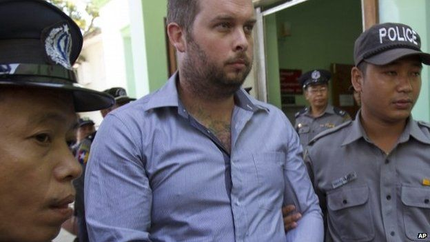 Philip Blackwood, centre, a New Zealander general manager of V Gastro Bar, is escorted by Myanmar police officers to face trial at a township court 26 December 2014, in Yangon, Myanmar.