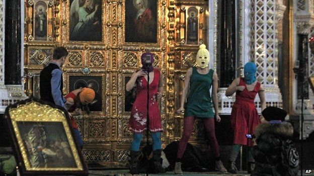 Members of the Russian radical feminist group Pussy Riot try to perform at the Christ the Saviour Cathedral in Moscow, 21 February 2012